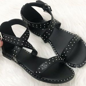 Black studded cross sandals